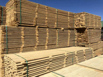 Long timber planks stacked